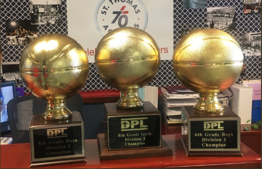 Wildcat Basketball Brings Home 3 DPL Championship Trophies